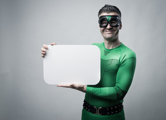 Superhero holding a blank sign