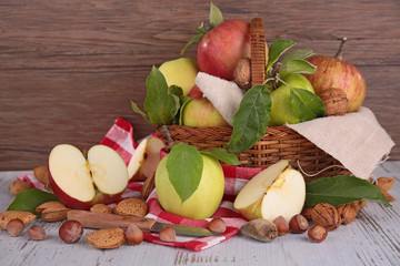apples and nuts in basket