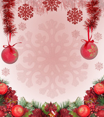 frame from red christmas decorations on pink