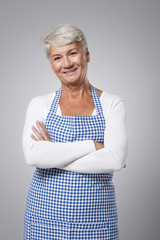 Portrait of cute grandmother wearing apron