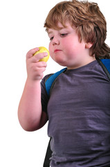 closeup portrait of boy eating an apple