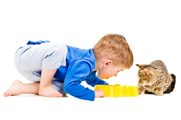 Boy eats a bowl of cat together with cat