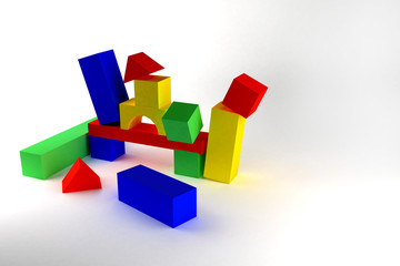 Destroyed toy castle from color blocks on a white background