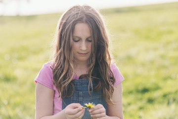 tween girl with daisy