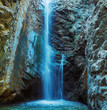 Leinwanddruck Bild - Millomeris Waterfall in Rock Cave, Troodos mountains