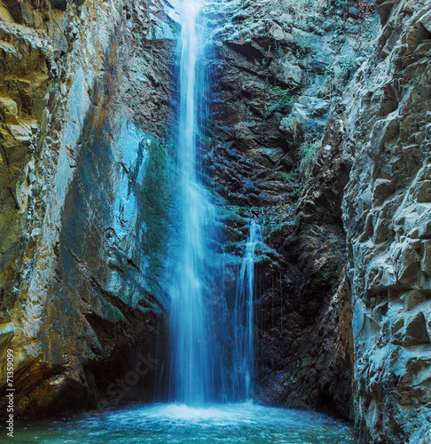 Poster Watervallen Millomeris Waterfall in Rock Cave, Troodos mountains