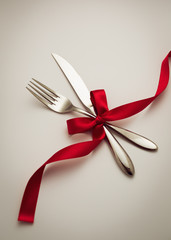 Fork and knife with decorative ribbon