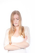 canvas print picture - Sad Blond Young Woman Crossing Arms