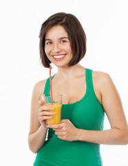 Beautiful brunette drinking an orange juice