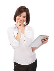 Smiling woman reading on a touchpad