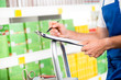 Supermarket clerk at work - 71361836