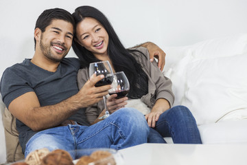 Asian Chinese Romantic Couple Drinking WIne