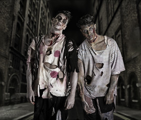 Two male zombies standing in empty city street