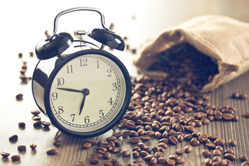 vintage alarm clock and coffee beans