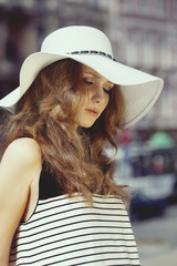 Woman in summer hat outside