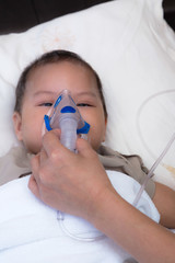 Baby using spacer for respiratory syncytial virus