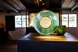 Green lass plate presented in Scandinavian glass manufactory poster