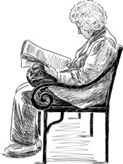 elderly woman reading a newspaper