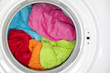 Wash machine with colored clothes inside - 71364883