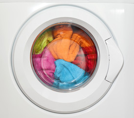 Wash machine with colored clothes inside