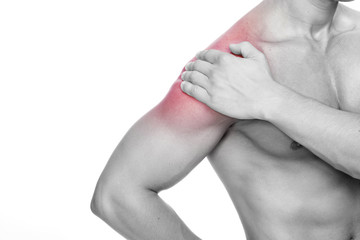 Young man holding his shoulder in pain, isolated on white backgr