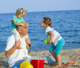 Children with Dad on  beach