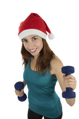 Christmas fitness woman with dumbbells