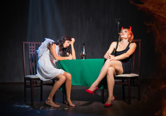 Angel and devil with brandy