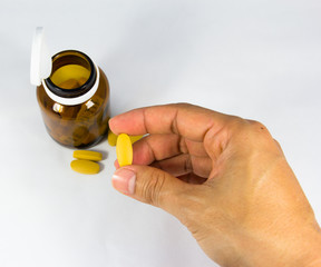 Yellow pill in hand