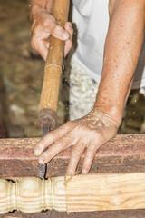 Wood turning Close up of a carpenter turning wood on a lathe.