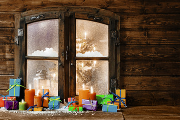 Gift-wrapped Christmas presents in a rustic cabin