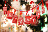 Small bags as Advent calendar with Sweets surprises hanging on a
