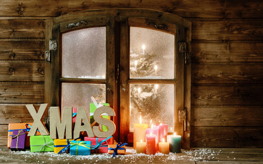 Christmas Gifts and Candle Lights at Window