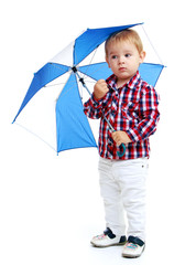 Little boy standing colored umbrella .