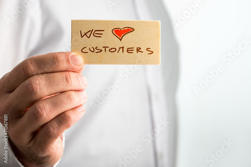 Hand Holding Small We Love Customer Signage - 71367881