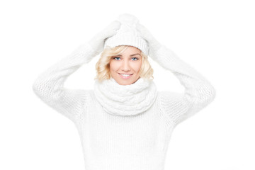 Beautiful young blond woman witch winter hat and scarf