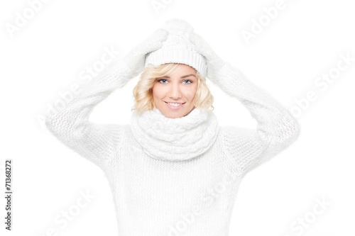 canvas print picture Beautiful young blond woman witch winter hat and scarf