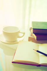 open book with cup of coffee in vintage light tone color