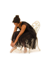African American Ballerina Prepares for Class