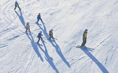 Instructor with a group of children. Austria
