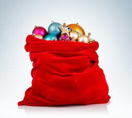 Santa Claus red bag with Christmas toys on background