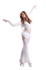 Graceful red-haired girl dressed as angel