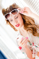 Pinup woman reading message on mobile phone