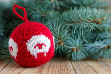 Knitted decor for new-year tree with the symbol of the year