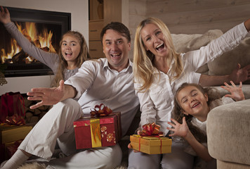 Happy Family at Home With Christmas Presents