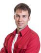 canvas print picture - Mann im roten Hemd schaut zur Kamera