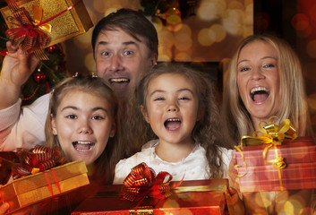 Young family with Christmas gifts