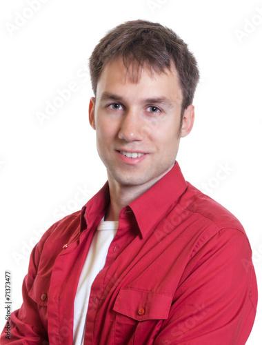 canvas print picture Mann im roten Hemd schaut zur Kamera