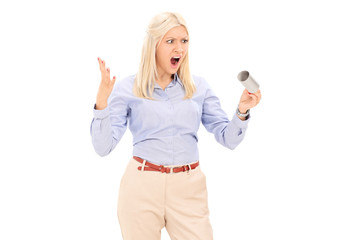 Angry woman holding an empty toilet paper roll