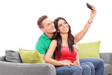 Woman taking a selfie with her boyfriend